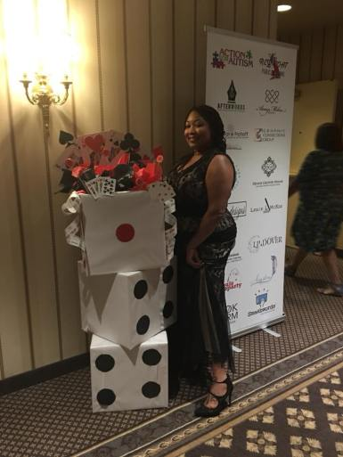 Joc Prothro posing with casino decor